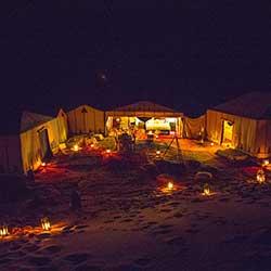 Sleep under the stars in Erg chebbi dunes camp